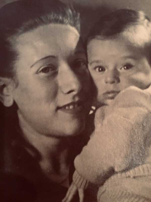 My mom, Sonia Symson, and me (Morrie) after immigrating to the United States with my father, Alter, in 1951. My mom, an Auschwitz survivor, and my dad, a partisan, met at a DP camp! They were the only survivors of their families. My dad passed away in 1963. My mother is listed in the Shoah Foundation Archives as Sonia Berson.