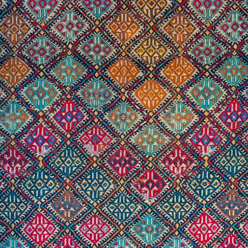 """This Armenian kilim (flat-woven rug) represents the lost historic homeland in the region of Lake Van, modern-day Turkey. The repetition of the star-and-cross pattern is a symbol of fertility and protection, both common themes in traditional Armenian carpet weaving. Van has a significant place in Armenian mythology and is widely recognized as a birthplace of the Armenian people. In the Visual History Archive, 345 Armenian Genocide survivors speak about Van, their beloved history and lost homeland.Learn more about the <a href=""""/collections/armenian"""">Armenian collection</a>"""