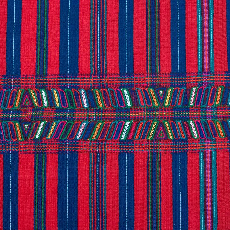 """This pattern by the artists of the Tejidos Cotzal Weaving Cooperative, many of whom are survivors of the Guatemalan Genocide, was chosen in collaboration with USC Shoah Foundation's partner, the Guatemalan Forensic Anthropology Foundation (FAFG). Working with FAFG, USC Shoah Foundation has launched a project to collect video testimonies of witnesses to the Guatemalan Genocide of the early 1980s.Learn more about the <a href=""""/collections/guatemalan"""">Guatemalan Collection</a>."""