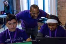 After School Matters instructor Michael Levesque helps students
