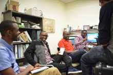 "L-R: Digital Officer Fabrice Musafiri, Camera Operator Patrick Nkubana, IT Specialist Clement Muhire, Claver Irakoze, talk with Consolee ""Madudu"" Uwamariya and Ryan Fenton-Strauss"
