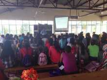 Davis Wamonhi gives a presentation to the camp about Rwandan history and genocide