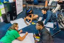 """Students complete the IWitness activity """"Finding Your Seat on the Bus"""" at Henry Ford Academy"""