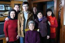 Survivor Wei Guiru and family