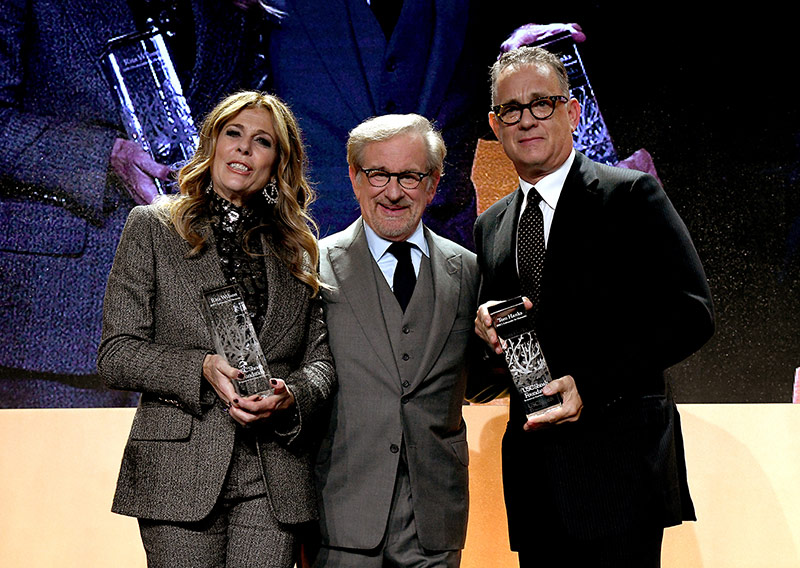 Steven Spielberg presenting Rita Wilson and Tom Hanks with the 2018 Ambassador for Humanity award